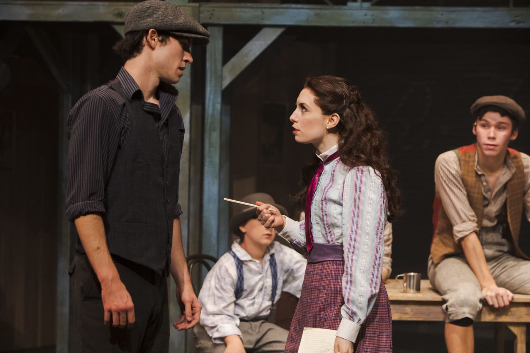 """Melissa Momboisse, as Katherine Plumber, questions Kamren Mahaney, as Jack Kelly, as she searches for her next story in """"Newsies"""" at Hillbarn Theatre."""