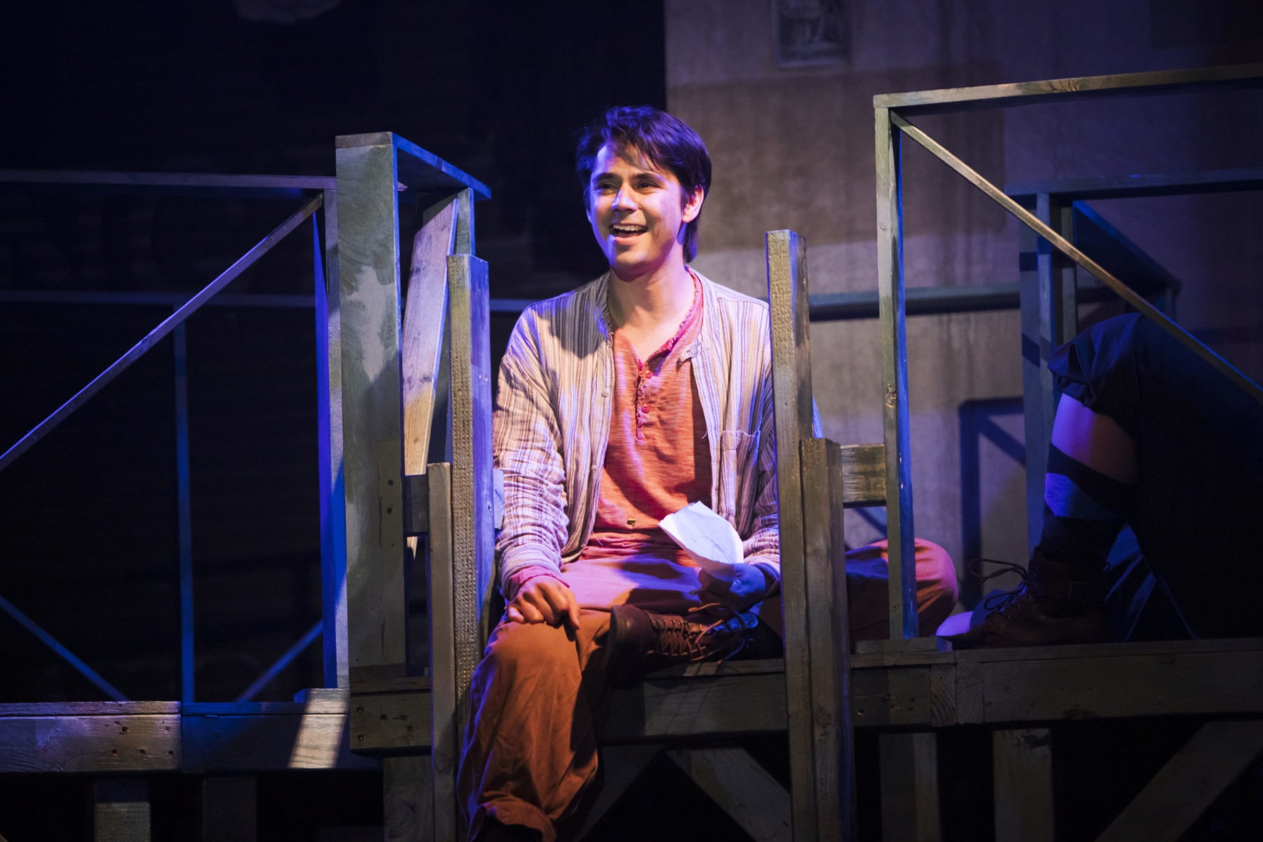 """Stephen Kanaski, as Crutchie, Writes a letter from the refuge in """"Newsies"""" at Hillbarn Theatre."""