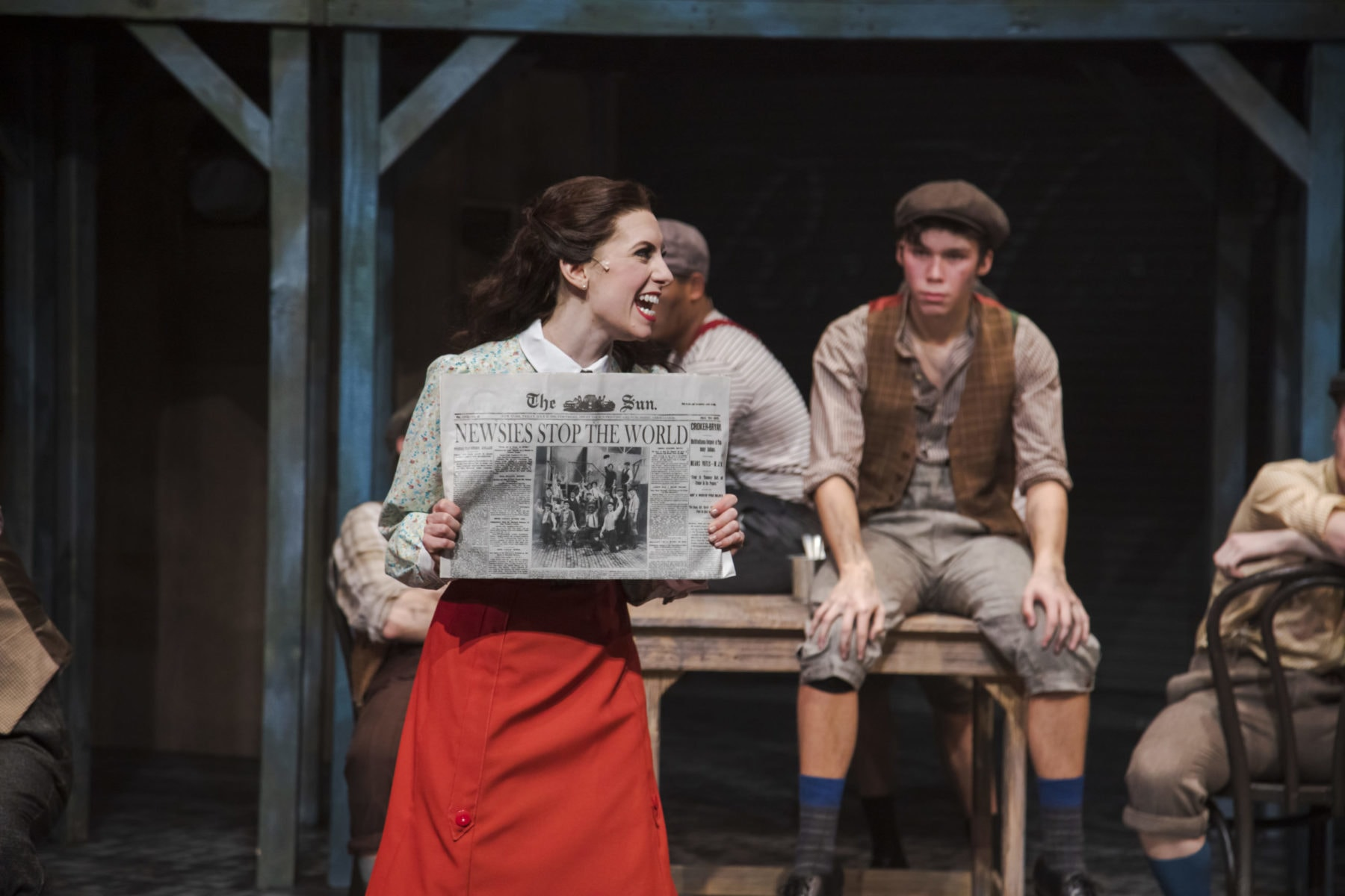 """Melissa Momboisse, as Katherine Plumber, shares the exciting front page news in """"Newsies"""" at Hillbarn Theatre."""
