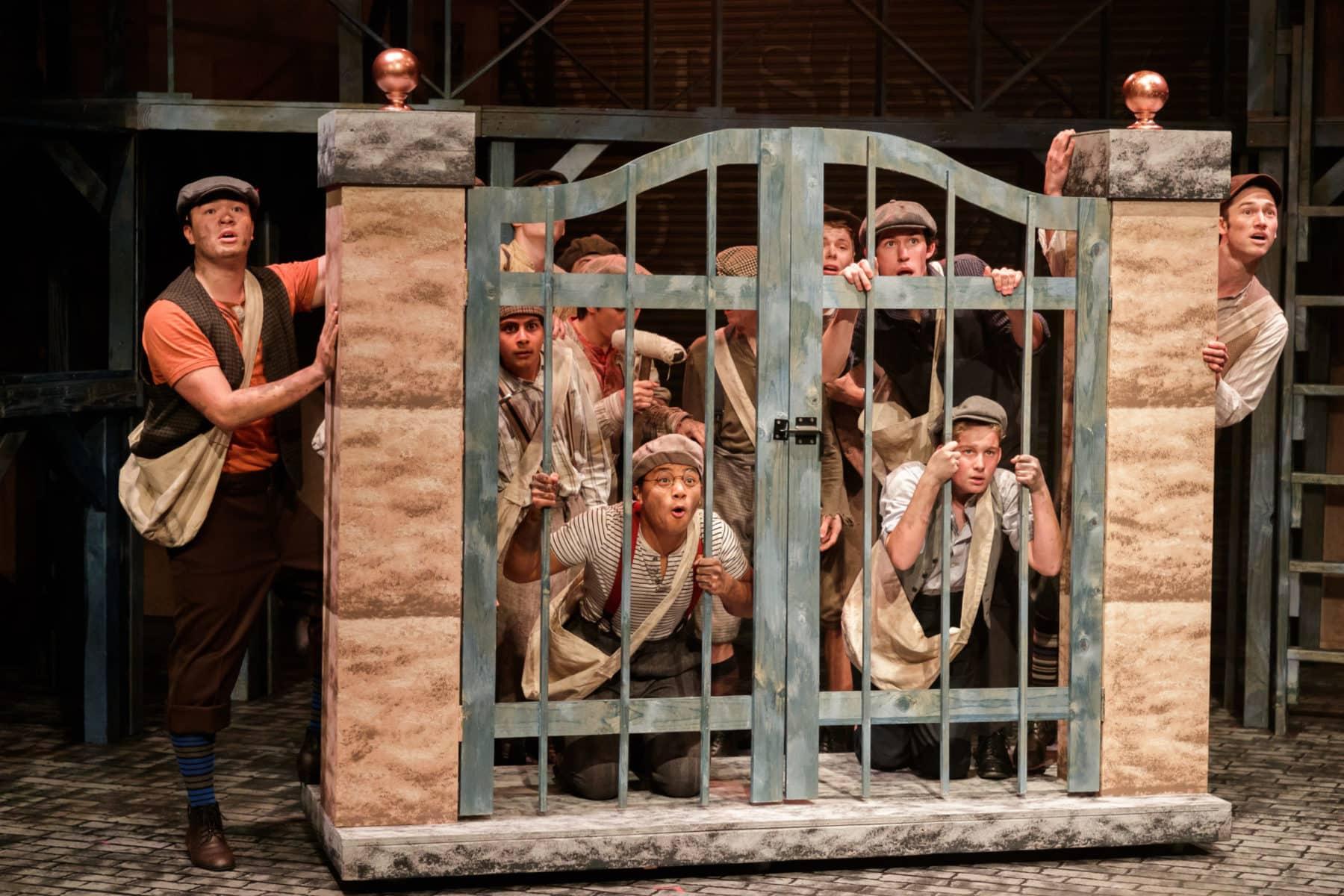 "The newsies await the days headline in ""Newsies"" at Hillbarn Theatre."