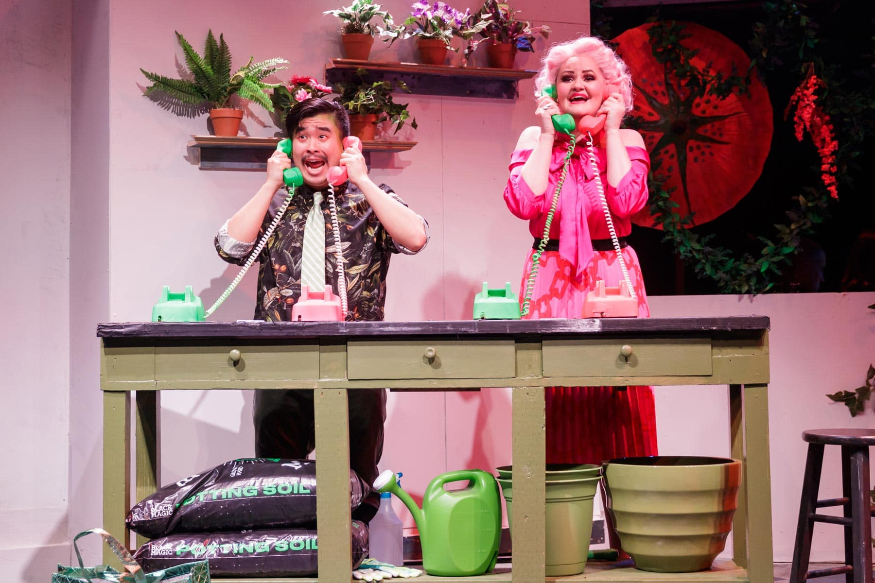Phil Wong as Seymore, and Jocelyn Pickett as Audrey, managing the new demand for flowers with their newly found success.